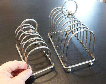 French chrome toast racks with ball feet and arched top.