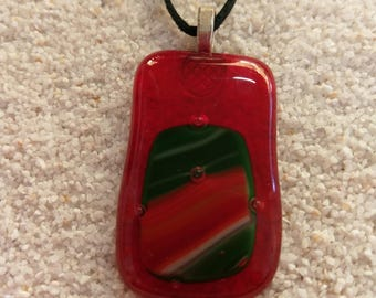 large red clear glass pendant with green and red highlights