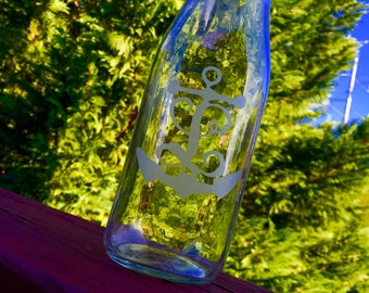 Hand etched glass bottle with L and anchor monogram