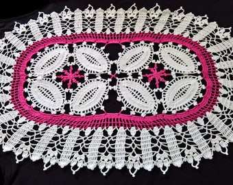 Pink and white oval placemat
