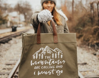 the mountains are calling and i must go weekender bag | handbag | travel bag | adventure | leather handles | hand lettered | calligraphy