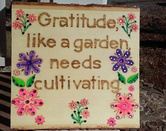 Wood burned and painted sign with Gratitude message embellished with colored crystals