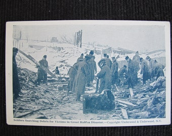 Soldiers searching debris for victims in great Halifax disaster / Halifax disaster postcard / 1917 maritime explosion / Underwood