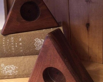 pair of triangular teak tea light holders