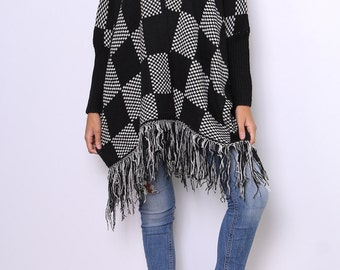 Poncho pattern square, sleeved, open, and fringes