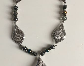 Silver necklace with black beads