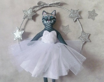 Cat in a tutu and his silver stars