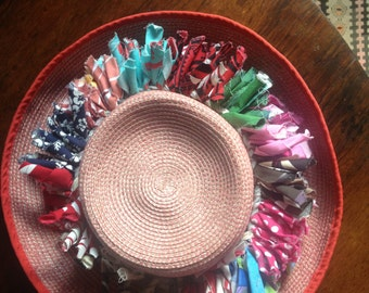 the first pic shows how the band looks on a hat. They can also be worn as a necklace or across a baby's bassinet