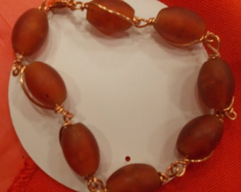 Orange hand-wrapped bead bracelet