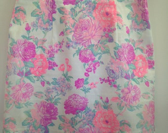 Size 8 size small white floral printed mini skirt pink and purple