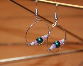 Silver hoop earrings with beaded bar across