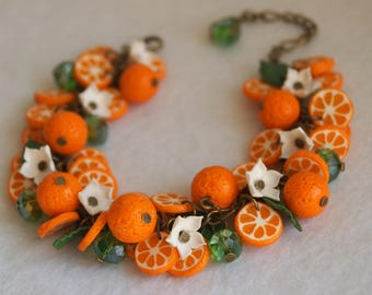 Set with oranges from polymer clay