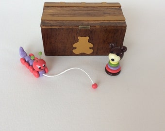 With toys miniature wooden chest