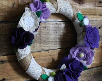 Burlap covered, purple flowered wreath