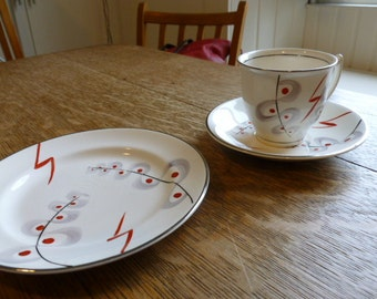 Crownford 12 piece tea service; white, grey and red, with silver rims; hand painted