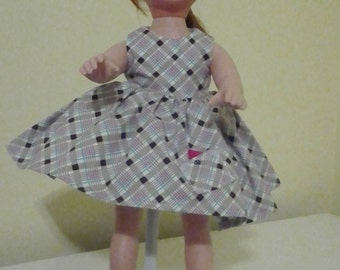 Print cotton dress doll not included. Dress color is brown and beige.