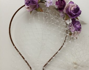 Floral bridal headpiece with birdcage veil.