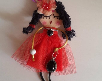 doll brooch in red
