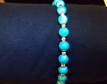 Turquoise glass beads with silver spacers