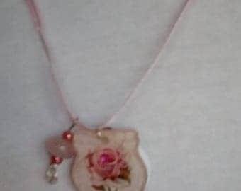 Pink rose acrylic pendant on pink ribbon