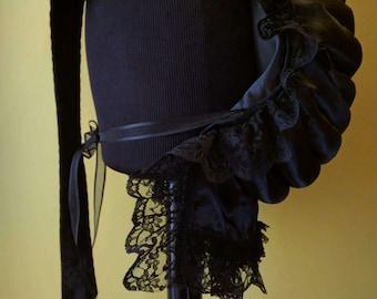 Victorian Style Bustle in black satin.