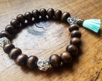 Boho bead bracelet with bright blue tassel, wooden bead bracelet, adjustable bead bracelet, rhinestone bead bracelet, yoga bracelet