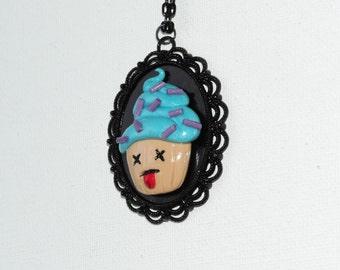Clearance Dead blue cupcake cameo pendant necklace. bitten cupcake. adjustable black color chain.