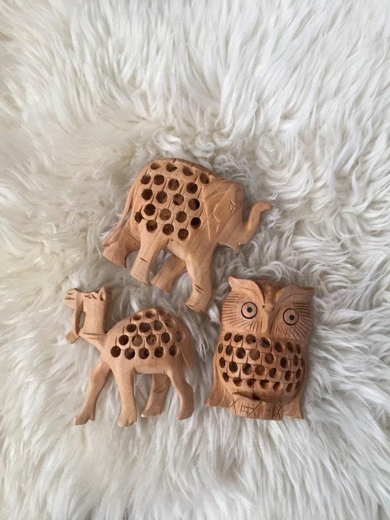 wood carved animal figurine / owl elephant camel / with baby inside