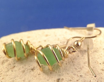 Spiral cage wrap green sea glass earrings, gold tone silver plated wire