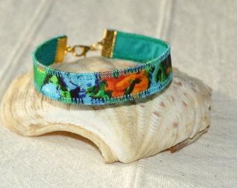 narrow cuff boho silk bracelet, textile bracelet, upcycled jewellery, silk jewellery, orange blue green, fashion bracelet, artisan jewellery