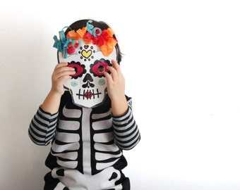 Girls skeleton black dress. Halloween and dress up wear. Sizes from 2 to 7 years. Made to order
