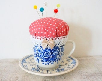 Teacup pincushion with dress makers pins
