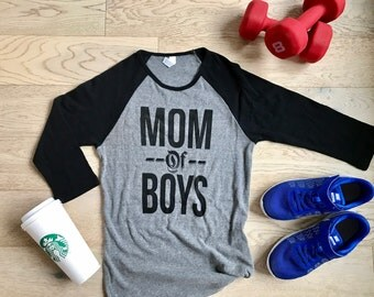 Mom Of Boys. Clothing. Women's T Shirts. T Shirts. Ladies Fit. Womens's Raglan Shirts. Baseball Raglan Shirts. Mothering Shirt. Mother's Day