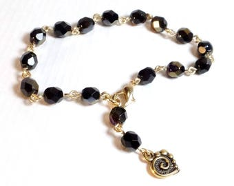 Black Iridescent Crystal Rosary Bead Style Bracelet with Small Gold Heart Charm
