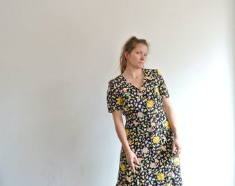 Dress by Betty Barckey in black and flower print