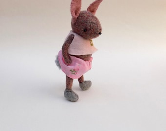 Woollen Rabbit  -  Handmade plush bunny wearing pink floral skirt, white pants and tiny pink smock top.