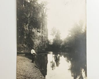 vintage black and white postcard of man fishing at webster bluff ha ha tonka