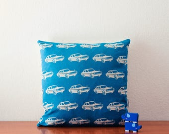 Blue turquoise cars pillow cover with off-white background canvas