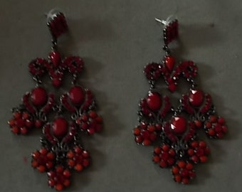 332.  Brilliant Red Stoned Stud Earrinfgs on a black base.