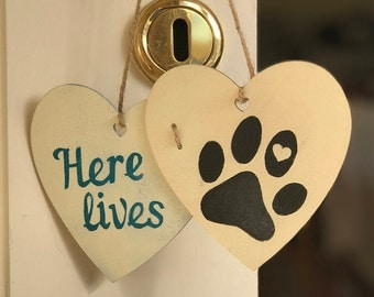 Wooden heart plaques with 'Here lives' + [your dog's name]