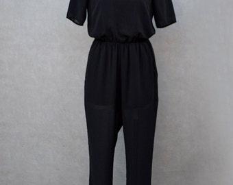 Jumpsuit Black with Unique Shoulder and Back Detail.