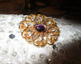 """vintage goldtone round brooch with purple stone/clear stones 1.1/2"""""""