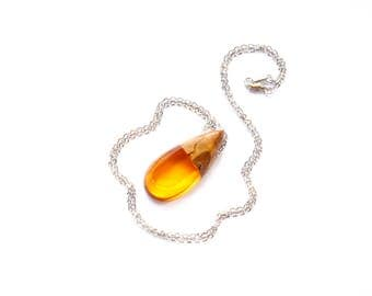 Tear drop shaped pendant / necklace handmade from Australian wood and orange resin