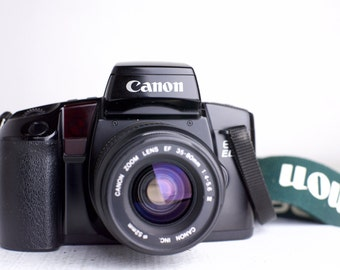 Canon EOS Elan 35mm Film SLR Camera with Canon EF 35-80mm Zoom Lens - Fully Funtional