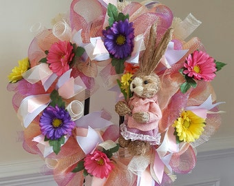 Spring wreath adorned with sisal bunny and pink, purple and yellow spring flowers