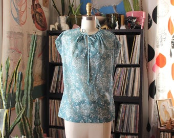 aquamarine sheer nylon top . 60s 70s blouse with keyhole tie front . womens medium large