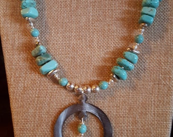 Brushed silver Squash Blossom with turquoise magnesite and silver accents
