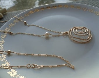Long gold chain, 585 gold filled with pearls and large spiral pendant