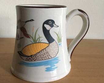 For Dad fantastic vintage cream ceramic mug with brown handle & rim and wide bottom shows Canadian geese / Canada geese enjoying nature!