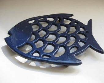 Vintage French blue cast iron coaster in the shape of a fish.